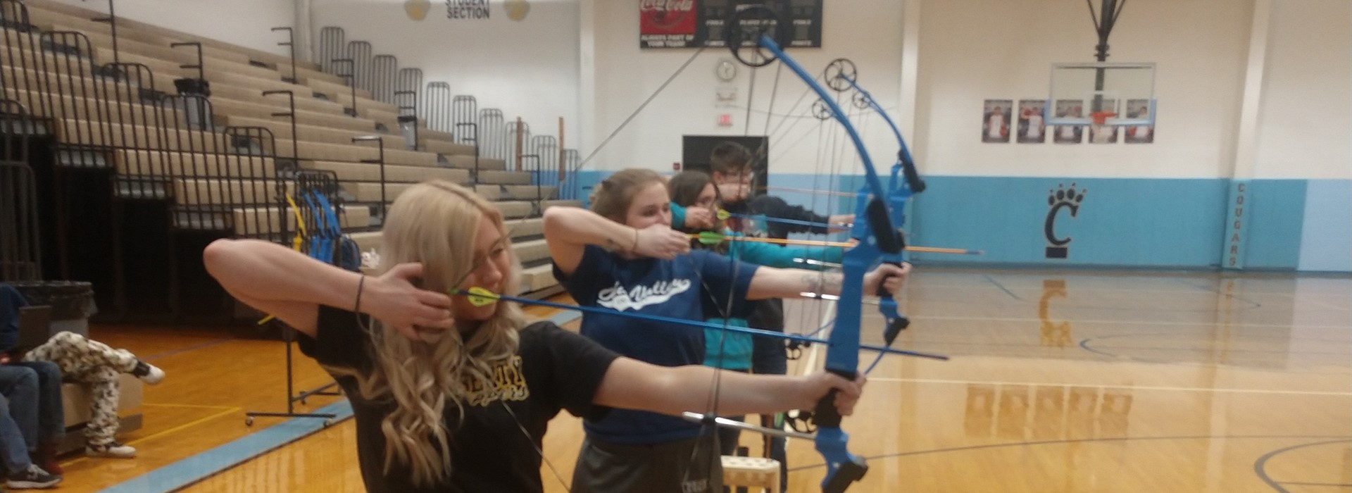 Students learning archery in Lifetime Sports