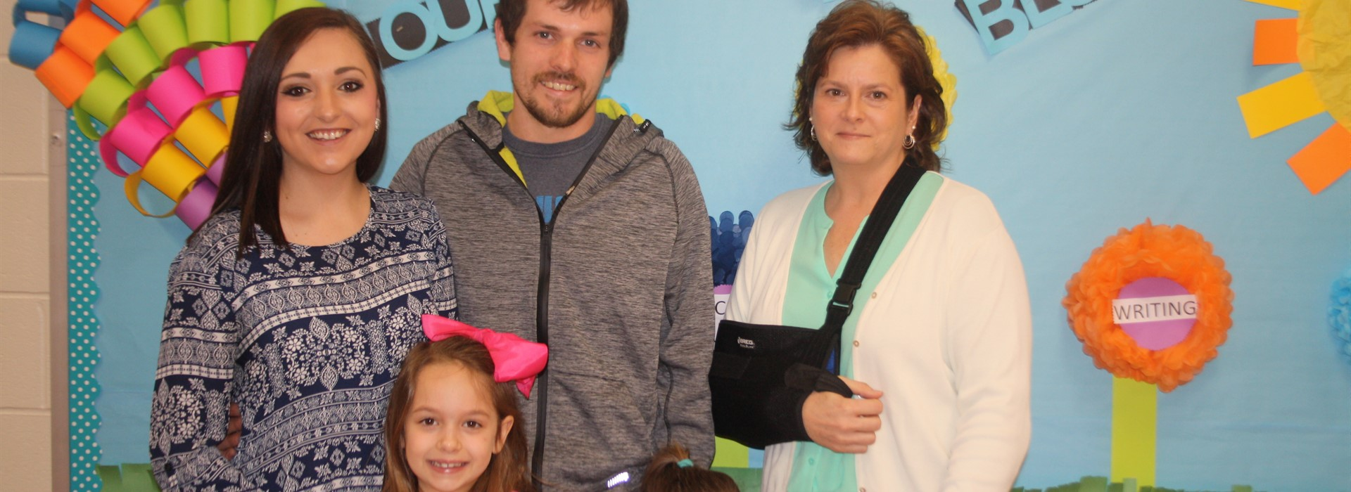 Kennedy Britton and Family with Ms. Ashworth after winning the Kindergarten Handwriting Award.